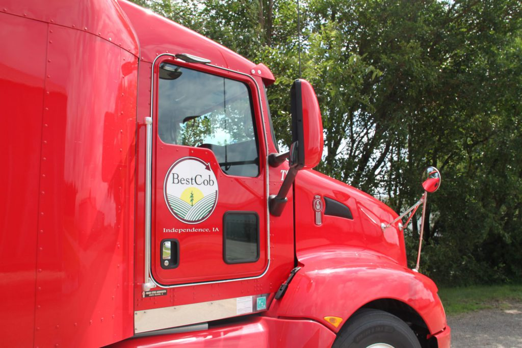 Close up of red Best Cob semi truck